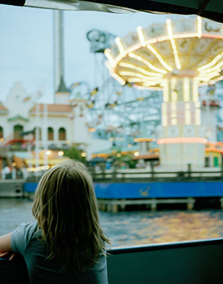 Girl and funfair.