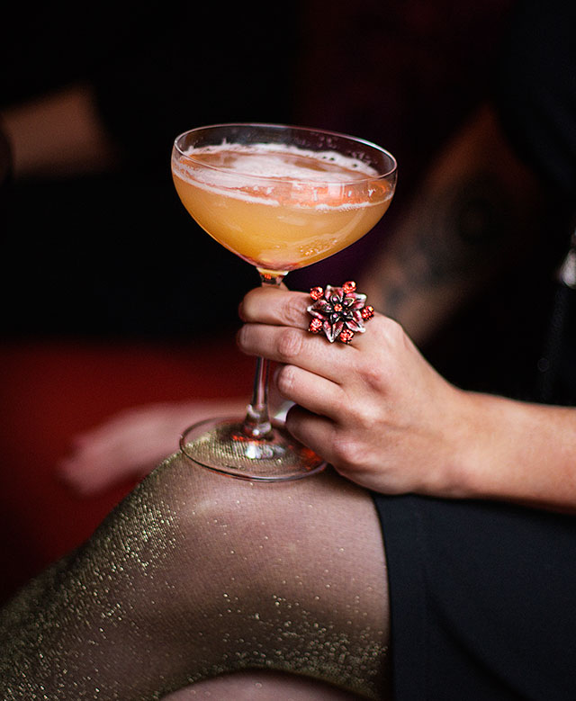 Woman holding a cocktail.